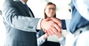 Man Shaking Hand For Flexible Working Arrangements IFA