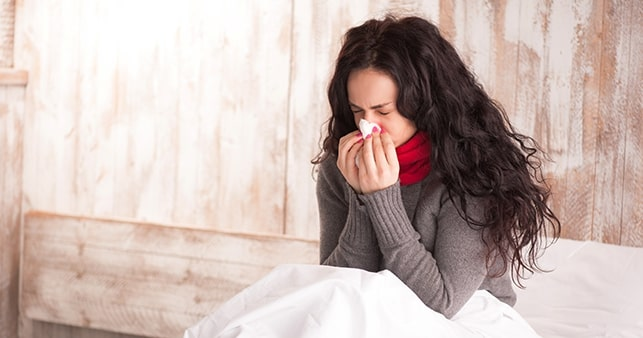 Women Sneezing Into Tissue At Home During Sick Leave Essential Work Update