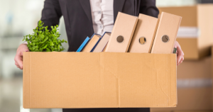 Employee Carrying Box Of Belongings After Termination Of Employment
