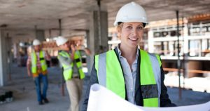 Woman In Hard Hat Holds Construction Plans Modern Awards