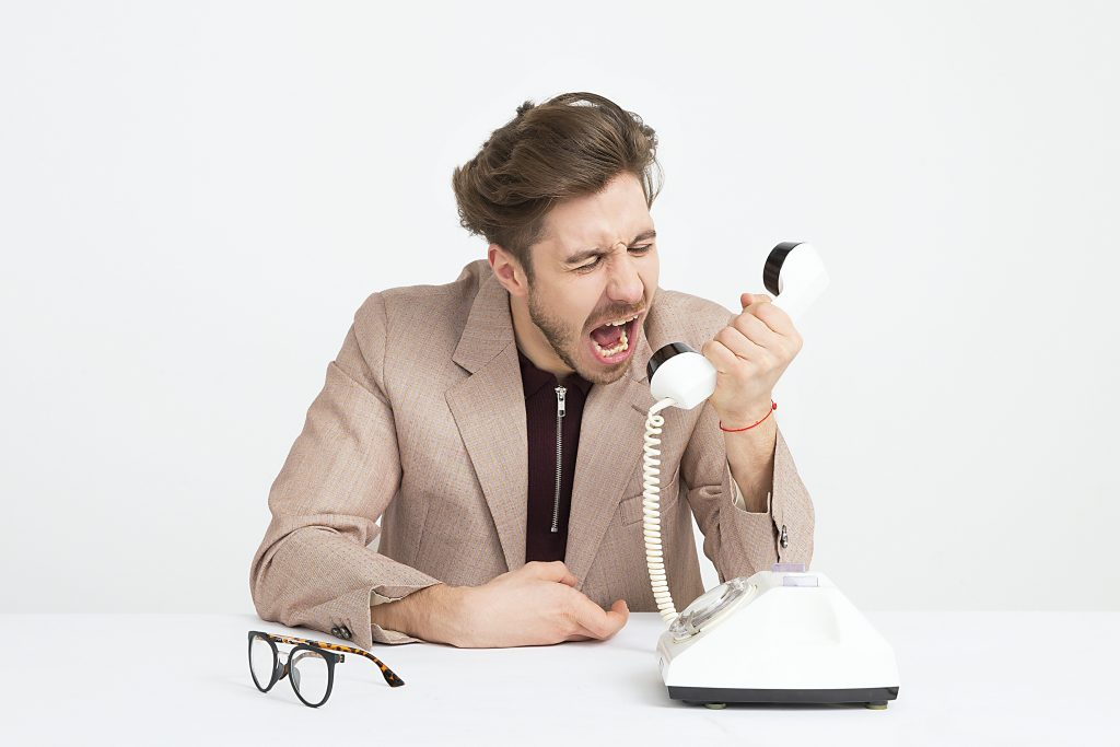 Man Yelling At Phone Workplace Bully