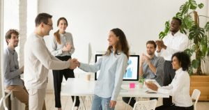 Boss And Employee Shaking Hands After Passing Probation