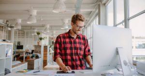 employee uses standing desk
